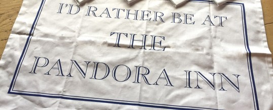 Clean up with a Pandora Inn tea towel!